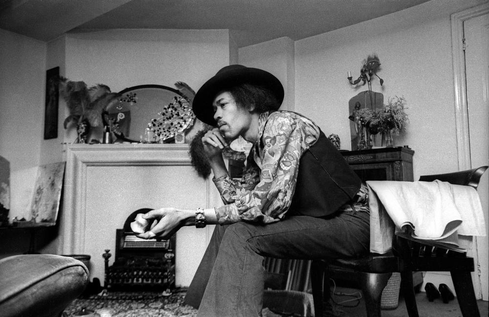 Jimi Hendrix in his apartment