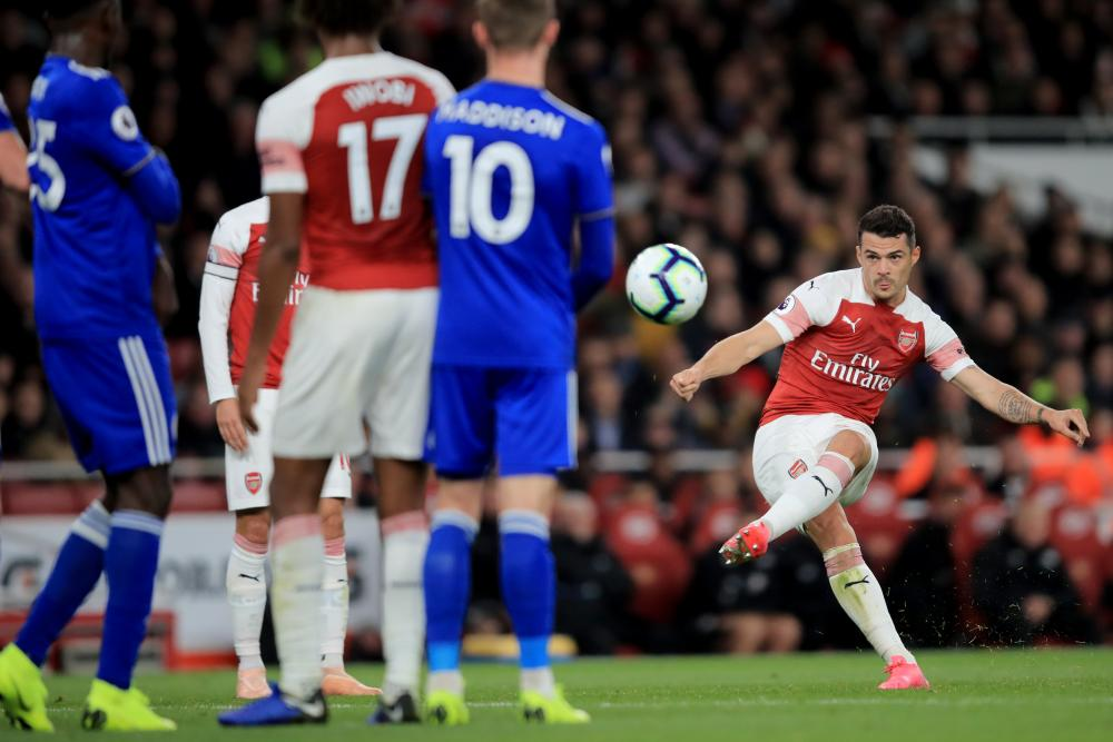 Granit Xhaka sees his free-kick saved by Schmeichel.
