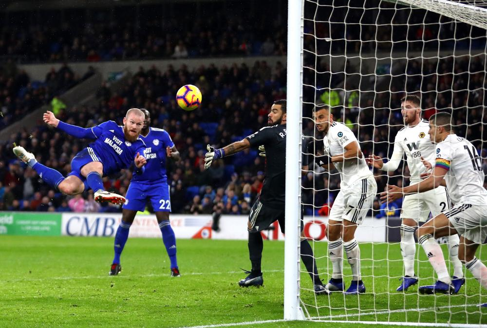November 30: Aron Gunnarsson of Cardiff City scores his side's first goal against Wolverhampton Wanderers at Cardiff City Stadium.