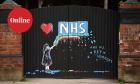 Graffiti depicting the logo of Britain's National Health Service (NHS) and a rainbow, in an outpouring of love and thanks to NHS staff and key workers involved in treating COVID-19 patients.