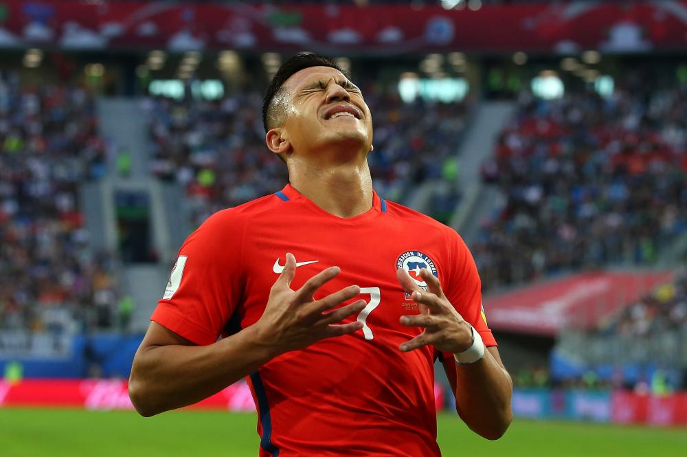 Alexis Sanchez reacts after a missed chance.