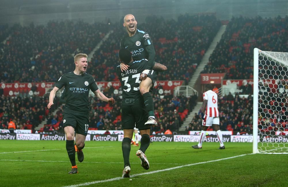 Silva is hoisted aloft in celebration.