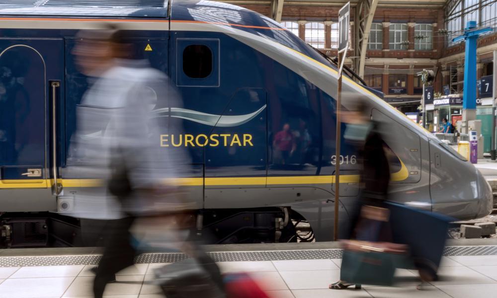 Passengers walking past Eurostar train