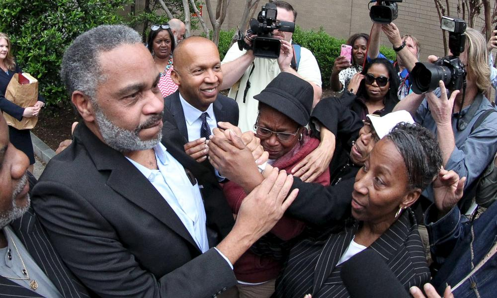 Free at last: Anthony Ray Hinton is greeted by family outside the Jefferson County Jail in Birmingham, Alabama.