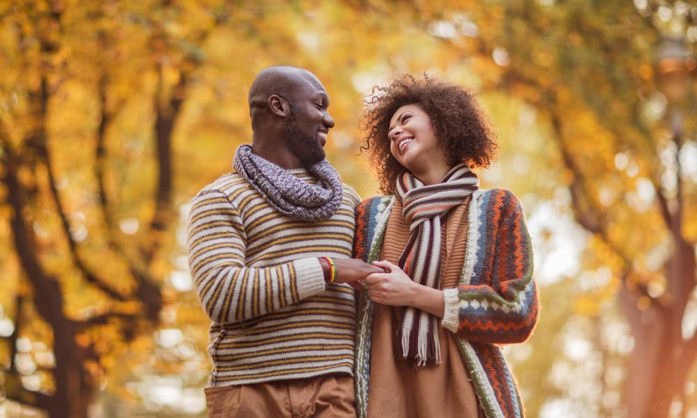 Affectionate couple in nature during autumn