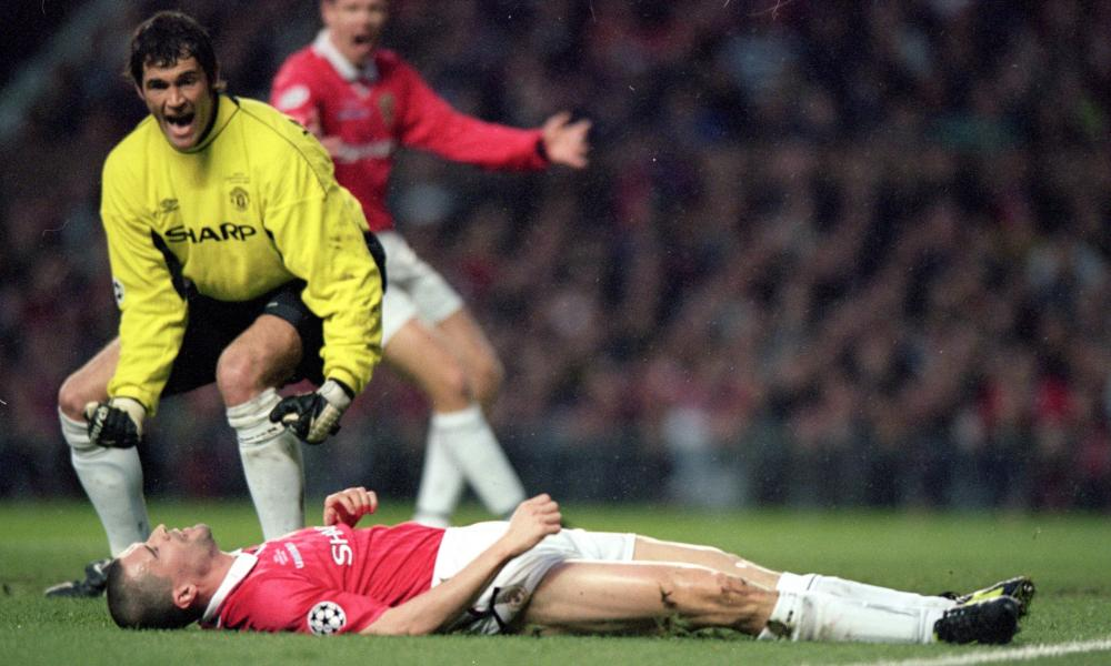 Roy Keane lies in despair after scoring an own goal in Manchester United's 3-2 defeat by Real Madrid in the Champions League in 2000.