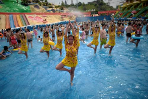 Practitioners mark International Yoga Day at a water park in Chongqing, China