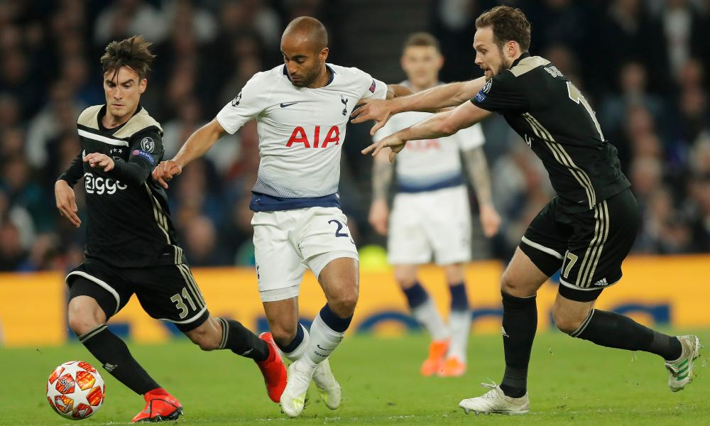 Tottenham's Lucas Moura is tackled by Daley Blind (right) and Nicolás Tagliafico.