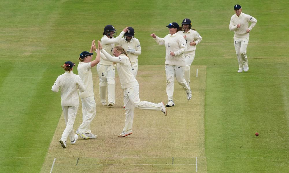 England players celebrate wicket of India's Kaur Harmanpreet.