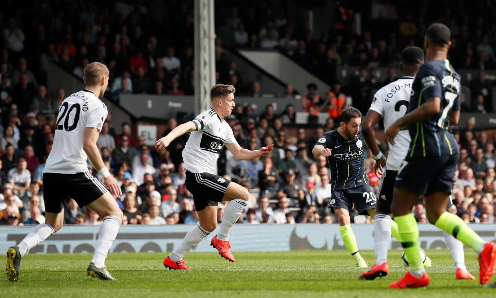 Manchester City's Bernardo Silva scores their first goal.