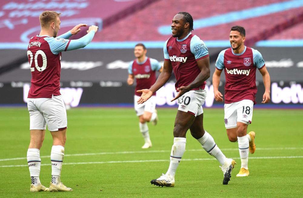 West Ham United's Michail Antonio (centre) celebrates scoring his side's first goal of the game with Jarrod Bowen.