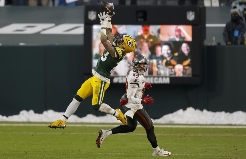 Green Bay's Jaire Alexander intercepts a pass intended for Tampa Bay's Mike Evans