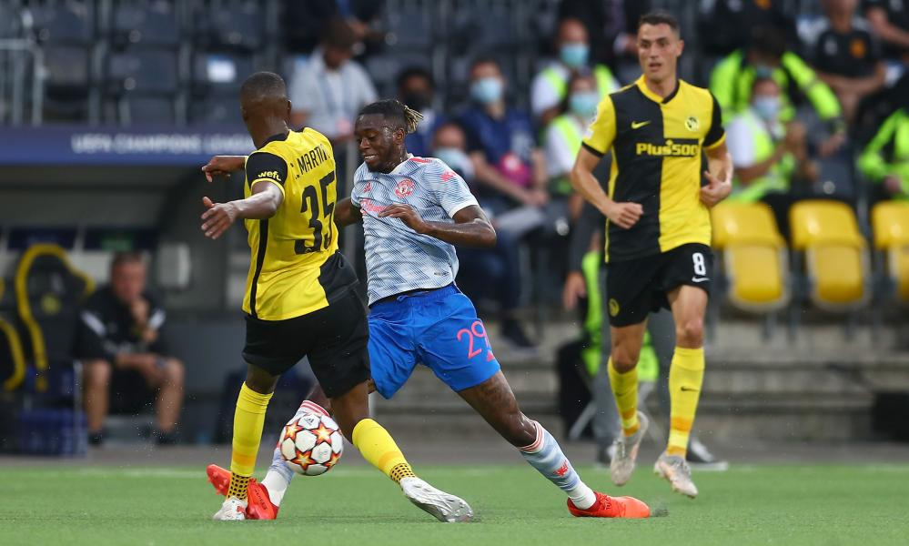 Aaron Wan-Bissaka of Manchester United is sent off for a challenge on Christopher Martins Pereira of Young Boys.