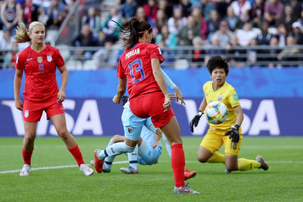 Alex Morgan slots the ball home but is thwarted by the referee's assistant's flag being raised for offside.