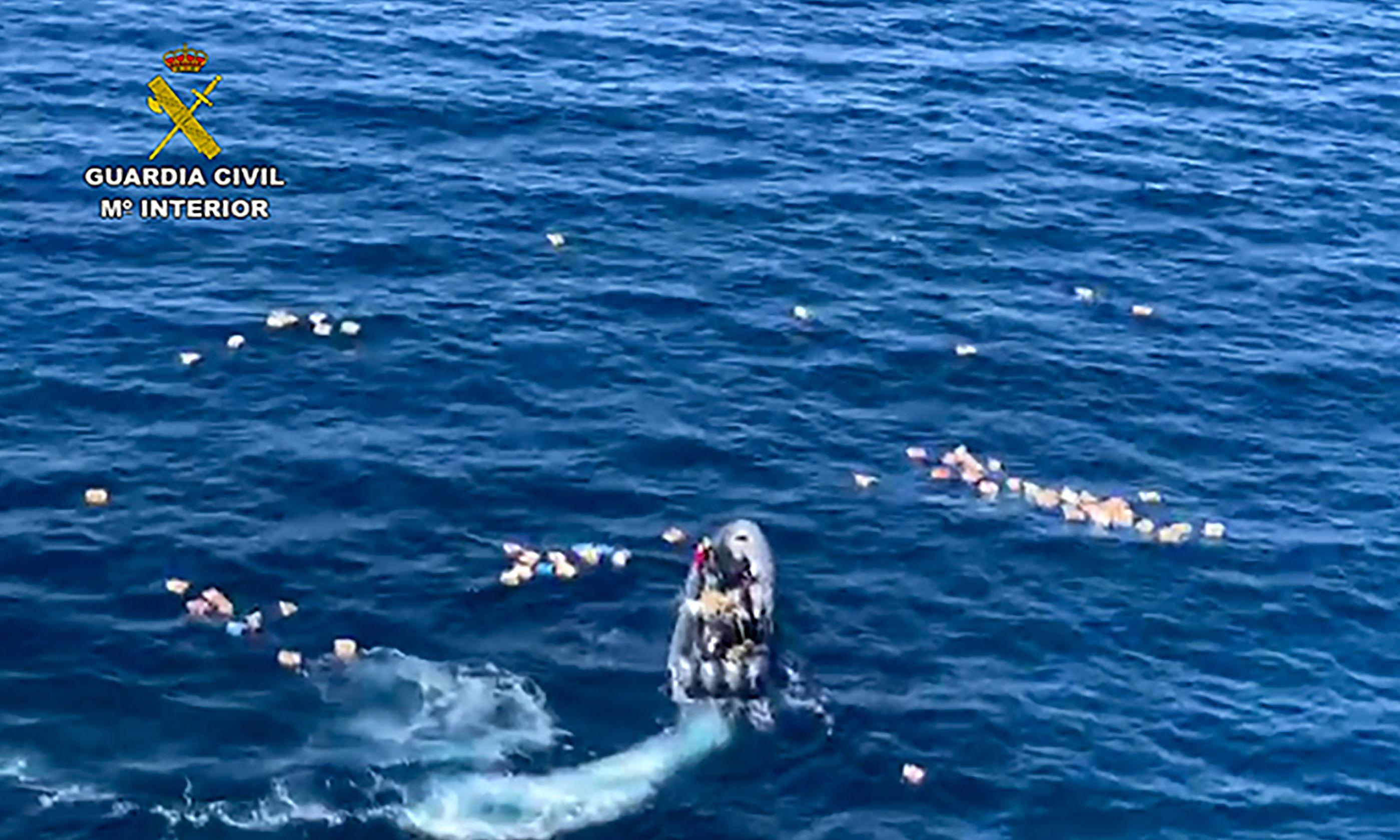 Spanish police plucked from ocean by drugs smugglers they were chasing