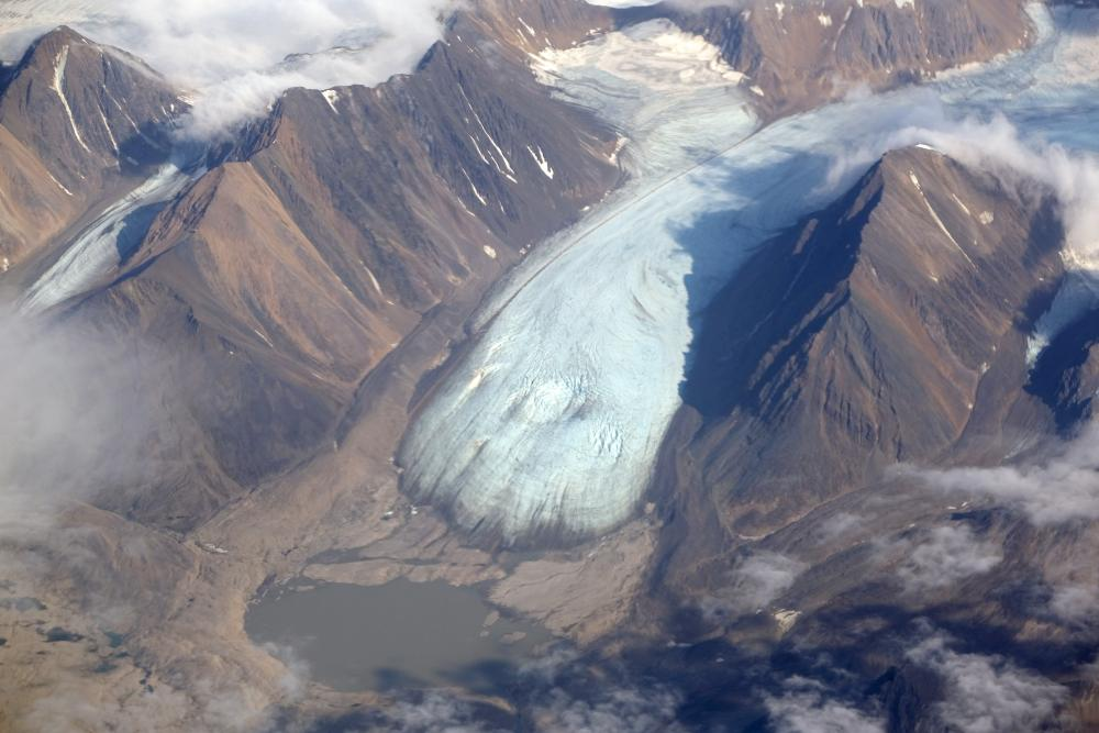 A melting glacier is seen during a summer heat wave on the Svalbard archipelago near Longyearbyen, Norway in July, 2020.