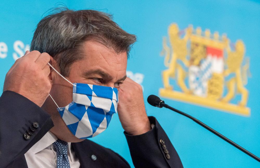 Bavaria's state premier, Markus Soeder, arrives for a press conference on Monday.