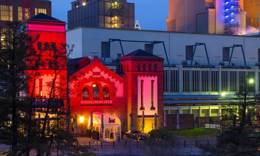 Luxury restaurant Druckwasserwerk with modern office buildings, Westhafen Pier 1, Frankfurt, Germany.