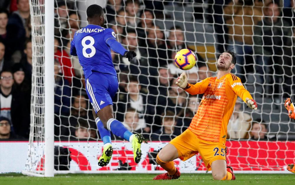Fulham's Sergio Rico makes the save from Kelechi Iheanacho.