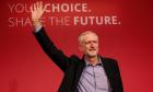 The new leader of Britain's opposition Labour Party Jeremy Corbyn waves after making his inaugural speech at the Queen Elizabeth Centre in central London, September 12, 2015.