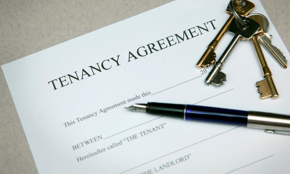 Signing a tenancy agreement.