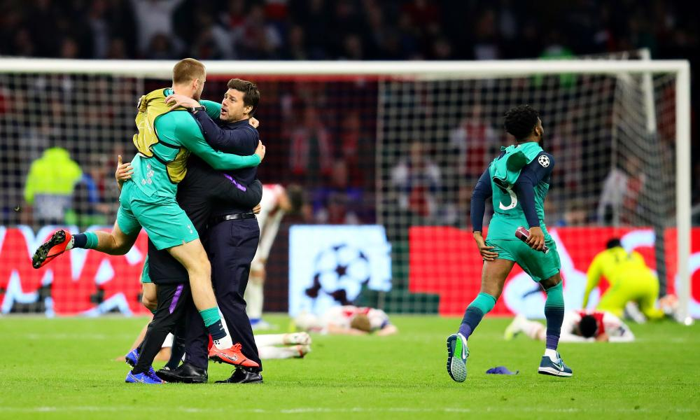 Eric Dier jumps on Mauricio Pochettino after the final whistle in Amsterdam, as Ajax's players lie crumpled on the turf.