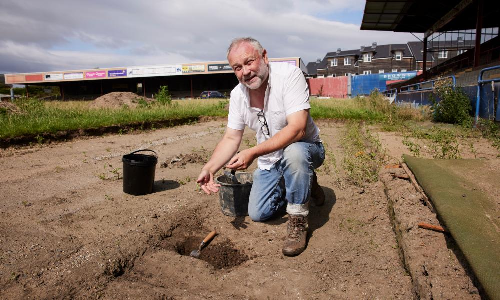 Jason Wood, archaeologist and heritage consultant on the project to memorialise the ground, searches for the ashes of fans buried underneath the pitch.