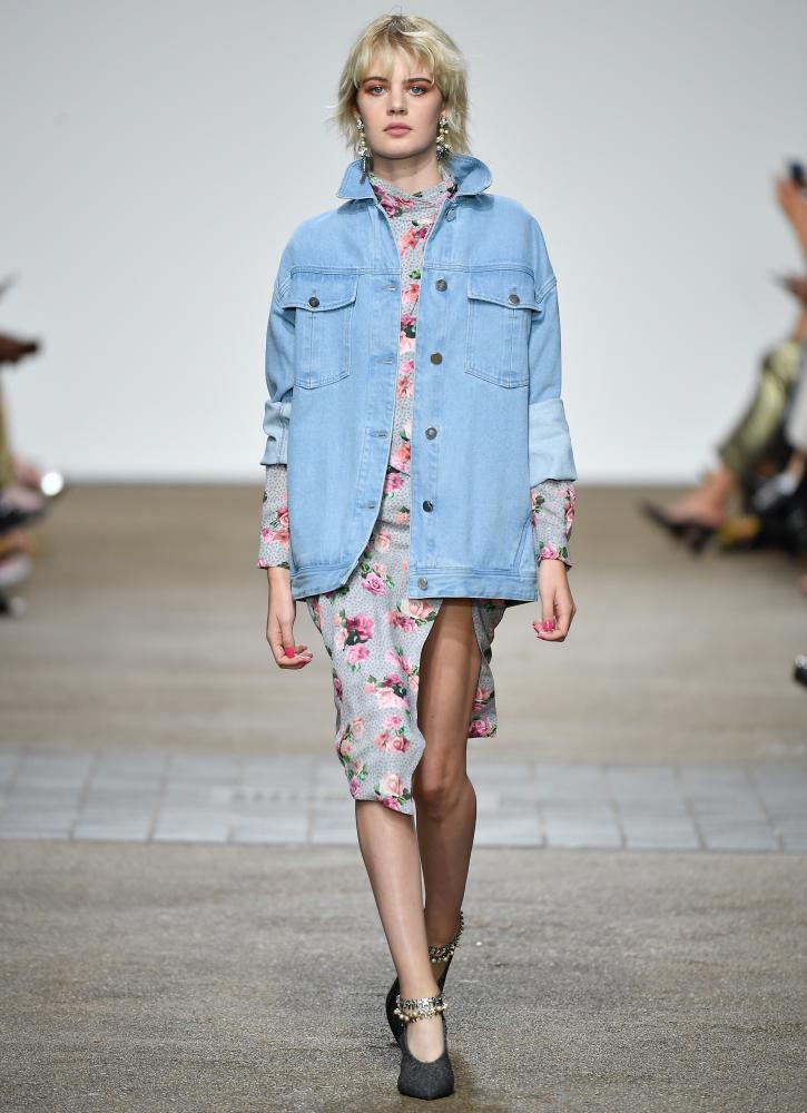 An oversized denim jacket over a floral dress, as seen at the Topshop Unique show.