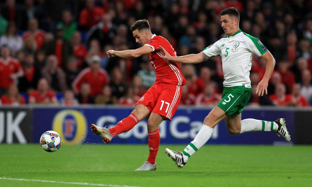 Wales' Tom Lawrence lashes the ball home to open the scoring in Cardiff.