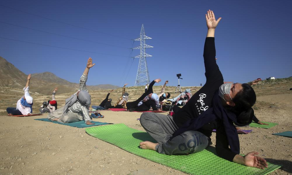 Afghan enthusiasts perform yoga to mark International Yoga Day during the Covid-19 pandemic lockdown, on the outskirts of Kabul, Afghanistan.