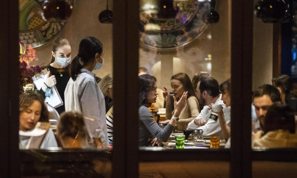 Diners at a restaurant in Patriarshiye Prudy, in Moscow, Russia.