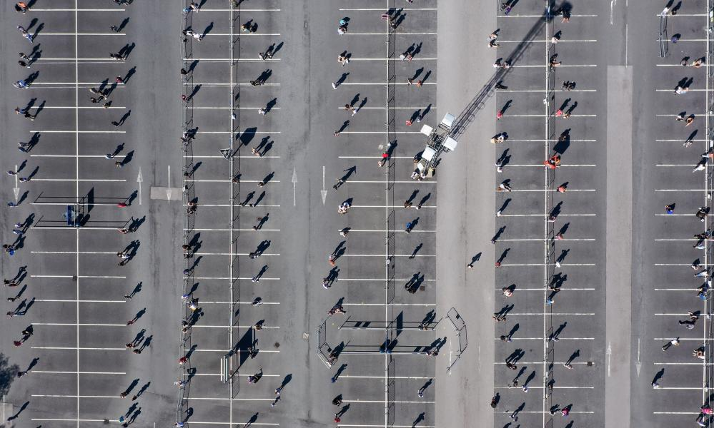 Customers socially distance themselves as they queue to enter Ikea in Warrington.