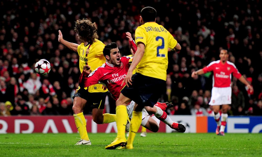 Cesc Fàbregas of Arsenal is brought down by Carles Puyol of Barcelona. Fàbregas scored the resulting penalty to earn a 2-2 draw for Arsenal, even though the tackle had fractured his fibula.
