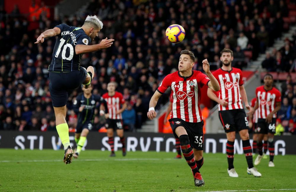 Manchester City's Sergio Aguero scores their third goal