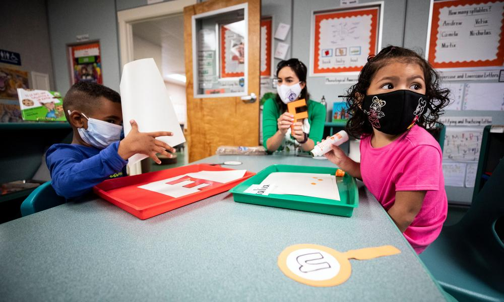 Students wear face masks in the classroom at Normont Early Education Center and Normont Elementary in Harbor City, south Los Angeles, California.