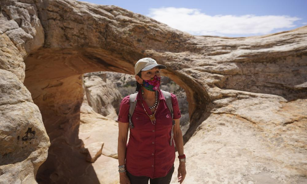 The US interior secretary, Deb Haaland, tours near ancient dwellings during a visit to Bears Ears.
