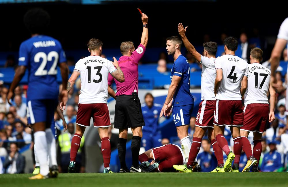 Gary Cahill is shown the red card by referee Craig Pawson.