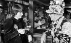 Harriet Harman, discusses the problems of Peckham's old people over a pint with Bankside's Pearly King Tom Johnson,in 1982