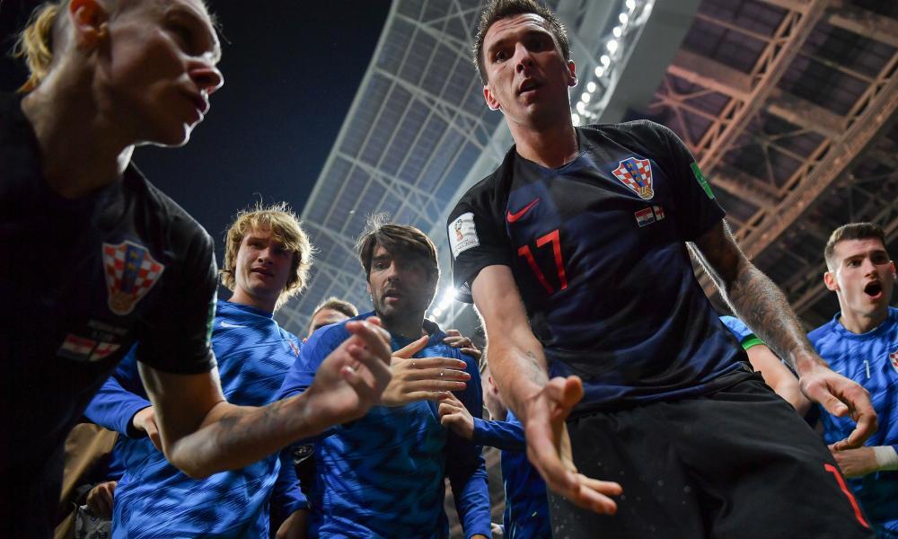 Croatia's forward Mario Mandzukic offers a hand to AFP photographer Yuri Cortez.