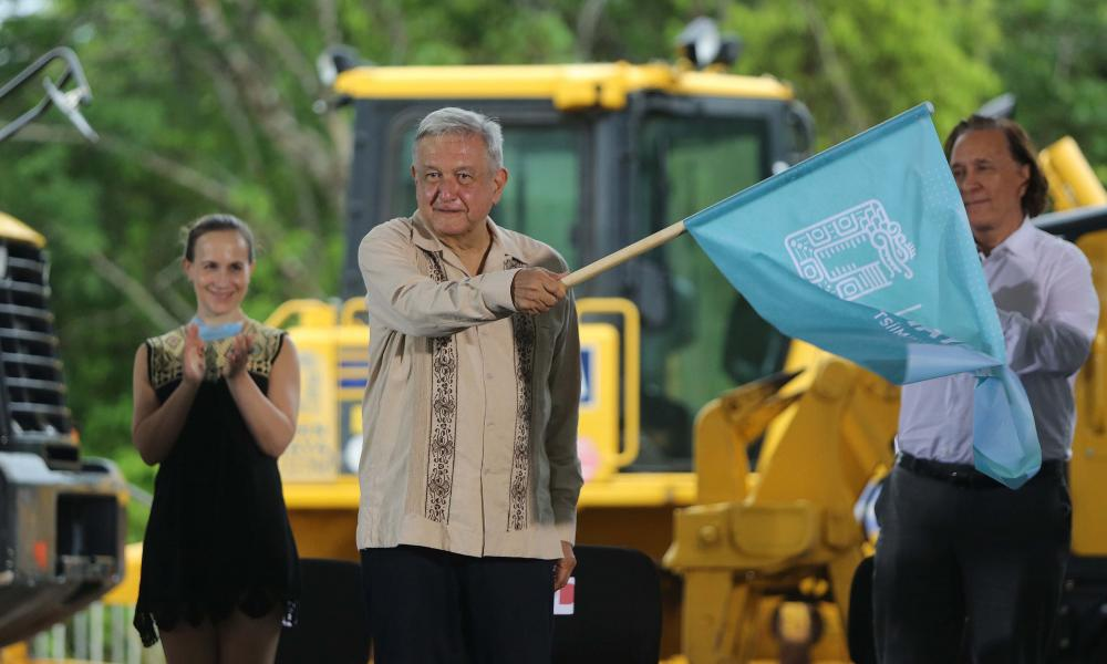 The President of Mexico, Andres Manuel Lopez Obrador, waves a flag during an event to mark the start of work on the fourth section, Izamal-Cancun, of the Mayan Train, in Lazaro Cardenas, Quintana Roo, Mexico, 1 June 2020.