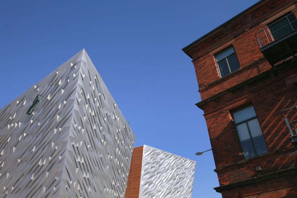 The Harland & Wolff offices (right), where the Titanic was designed, is being transformed into the Titanic Hotel. The Titanic Belfast visitor centre is on the left.