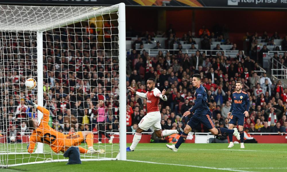 Alexandre Lacazette scores his and Arsenal's second with a bit of help from Neto and goal-line technology.