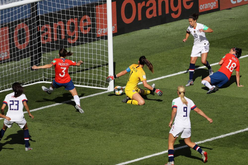 Claudia Endler of Chile saves from Carli Lloyd of the USA.