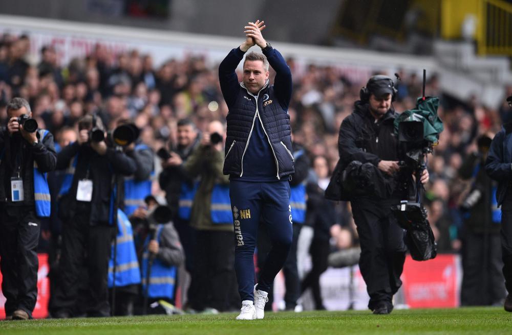 Neil Harris applauds the fans ahead of kick-off.