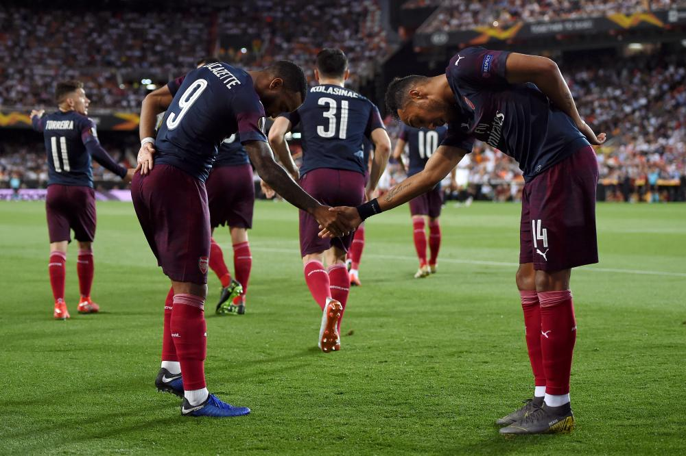 Lacazette joins in the celebrations.