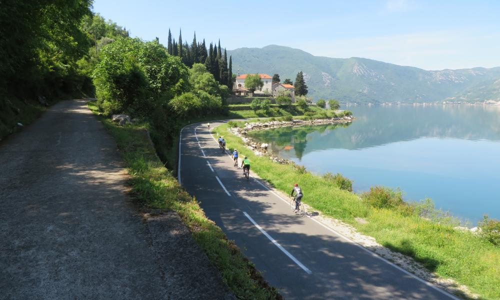 Cyclists on coastal road on the Balkans trilogy tour.