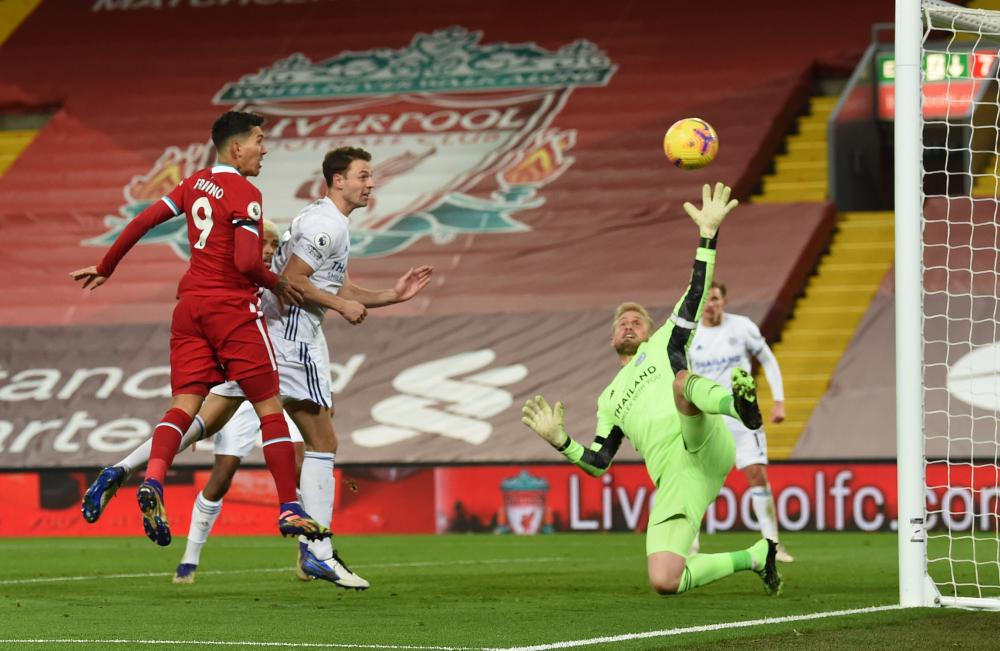 Roberto Firmino's effort hits the post and then the rebound is cleared off the line.