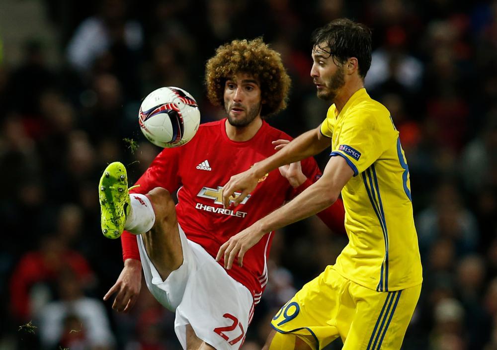 Manchester United's Marouane Fellaini flicks the ball away from Rostov's Aleksandr Erokhin.