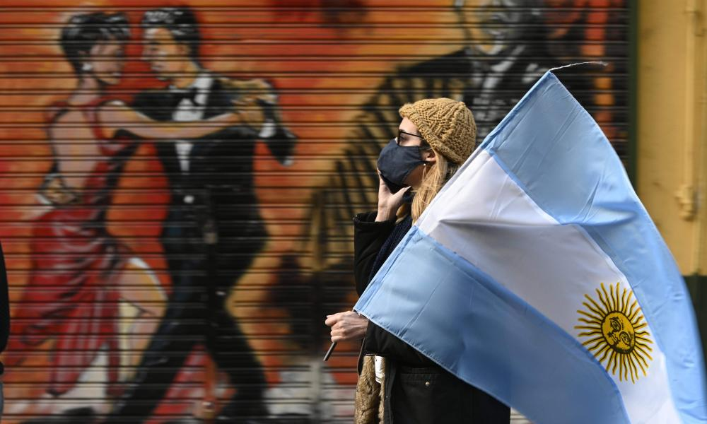 A woman holds an Argentine flag during a protest against Argentina's President Alberto Fernandez.