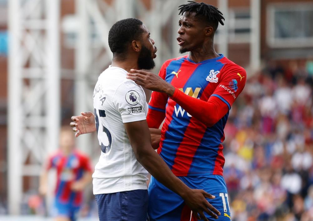 Tottenham Hotspur's Japhet Tanganga clashes with Crystal Palace's Wilfried Zaha.